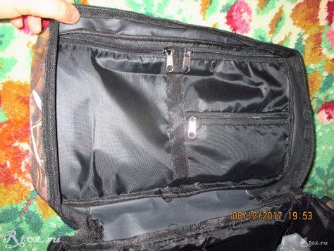 Внутренние карманы на крышке сумки